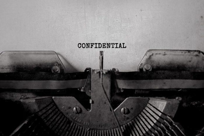 máquina de escrever escrito confidentiality
